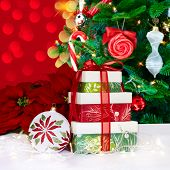 White, Green And Red Holiday Ornament And Presents Over Christmas Tree And Led Light Background