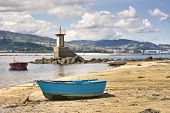 Boats and lamp on Lourido Beach, Poio