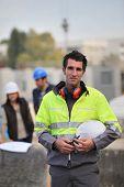 Foreman surveying construction