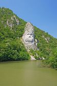 stock photo of decebal  - Rock sculpture of Dacian king Decebal on Danube river - JPG