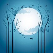 Starry Halloween night.   Dried trees in the night with bats.  Blank spaces at the center for design and text.