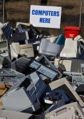 stock photo of reprocess  - Unwanted computers and monitors piled up for recycling - JPG