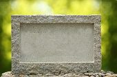 Empty Granite Signboard With Border & Frame. The Granite Is Placed In Natural Outdoor Settings Showi