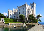 The Miramare Castle in Trieste, a nineteenth-century castle of white stone perched above the Adriati