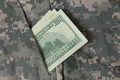 Dollars in uniform pocket