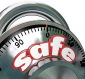 The word Safe on a shiny metal combination lock giving you peace of mind that your assets are protec