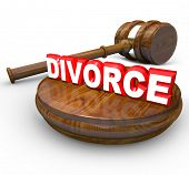 A judge's gavel and the word Divorce, symbolizing the end of a marriage by means of legal action and a court case with attorney before a judge to reach a settlement