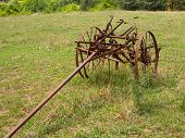 foto of horse plowing  - Rusted farm plow or plough pulled by horse in a field on farm - JPG