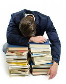 Young Man Falling Asleep On Books