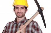 A construction worker with a pickaxe.