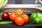 pic of mixing faucet  - Fresh vegetables in kitchen before cooking - JPG