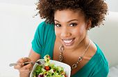 Close-up Of Beautiful African American Woman Eating Salad