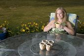 Woman On Patio With Coffee Thinking