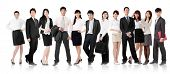 Asian business team, businesswoman and businessman in group standing and looking at you, isolated on