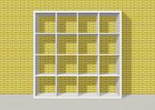 White Empty Square Bookshelf On Yellow Brick Wall Background