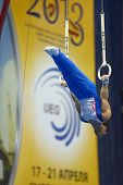 Moscow, Russia - April 20, 2013: Samir Ait Said, France performs exercise on still rings in final of 5th European Championships in Artistic Gymnastics in Moscow, Russia on April 20, 2013