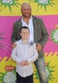 LOS ANGELES - MARCH 23:  Randy Couture & son Caden arrives to the Kid's Choice Awards 2013  on March