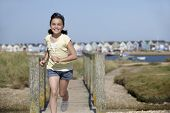 Young Girl Running Towards Camera