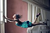 beautiful woman fly opening the window