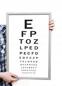 stock photo of snellen chart  - Man showing Snellen eye exam chart on white background - JPG