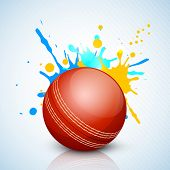 Cricket ball on grungy colorful background.