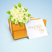 Gift box, flowers and tag with text mothers day, concept for Happy Mothers Day celebration.