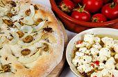 Focaccia bread with tomato and cheese.