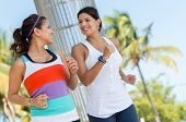 Women running outdoors living a healthy lifestyle