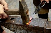 stock photo of blacksmith shop  - blacksmith working process with tools and fire view - JPG