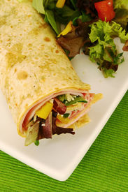 pic of sandwich wrap  - Ham wrap with fresh salad in a plate