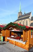 PILSEN CZECH REPUBLIC - DECEMBER 3:  a market stall with smoked meat on the Christmas market in the