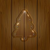 Glassy Christmas tree on wooden background
