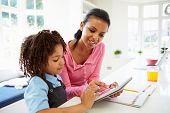 image of homework  - Mother And Child Using Digital Tablet For Homework - JPG