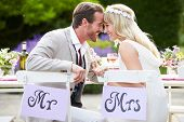 stock photo of ats  - Bride And Groom Enjoying Meal At Wedding Reception - JPG