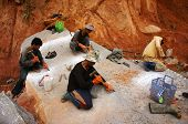 Workers Carve Out Large Rock  By Hammer And Splitter