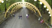 MOSCOW - SEP 22: (view from unmanned quadrocopter) People walk under illuminated arc in park Sokolniki, on Sep 22, 2013 in Moscow, Russia.
