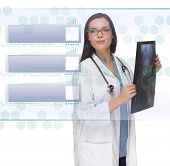 Young Doctor or Nurse Holding X-Ray Reading Over Blank Futuristic Translucent Panel - Ready For Your