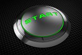 Green Led Start Button On Black Background.