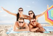 summer, holidays, vacation and happy people concept - group of smiling people in sunglasses having f