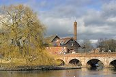 stock photo of avon  - The old footbridge and mill on the River Avon - JPG