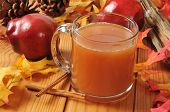 foto of cider apples  - A cup of hot apple cider on an autumn table setting - JPG