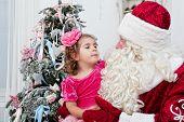 little girl talks to Saint Nicolas