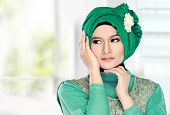 picture of muslimah  - Fashion portrait of young beautiful muslim woman with green costume wearing hijab - JPG