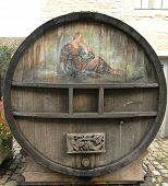 An old painted wine barrel in Chateau de Pommard in France