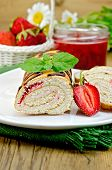 Roulade With A Jar Of Jam And Strawberries On A Board