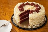 foto of red velvet cake  - Red velvet cake on the table with a fork and spoon