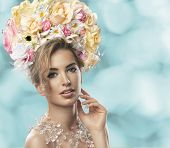 stock photo of chest hair  - fashion model with large hairstyle and flowers in her hair - JPG