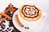 foto of scum  - Cappuccino cup with drawing on scum and coffee beans - JPG