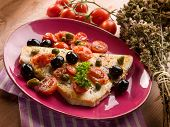 swordfish with tomatoes capers and olive,traditional sicily recipe