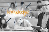 The word knowledge against lecturer standing in front of his class in lecture hall